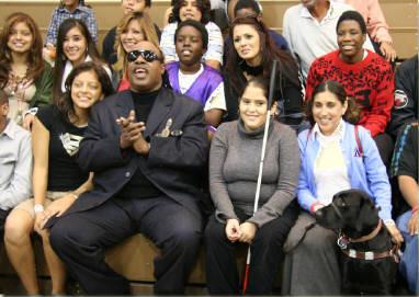 Melissa And Anya Sing Along With Stevie Wonder At The JBA Holiday Party