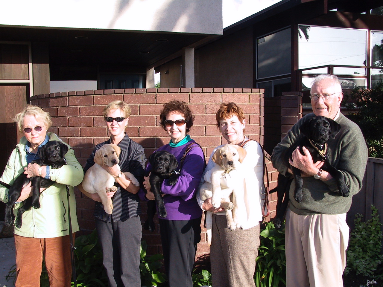 5 Niles pups: Judy w/ Tuck; Gail w/ Beverly; Pat w/ Tola; Joan w/ Butch; Bill w/ Hark