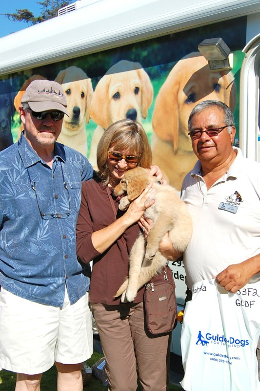 Peggy and Greg with Natalia at the Puppy Truck