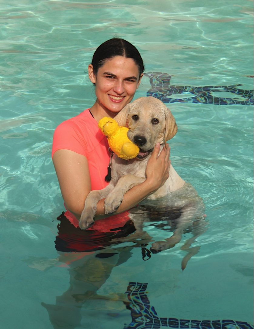 Elizabeth with Milo in the pool