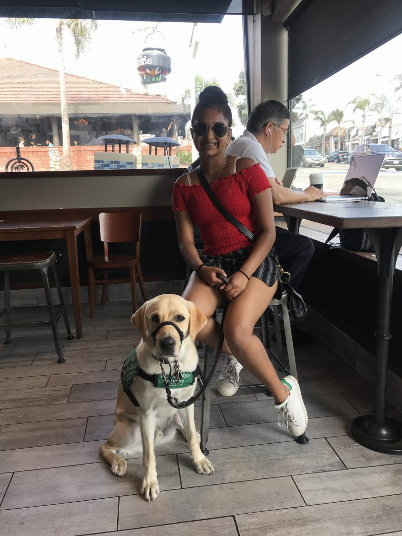 Avanthi with Dover at a restaurant