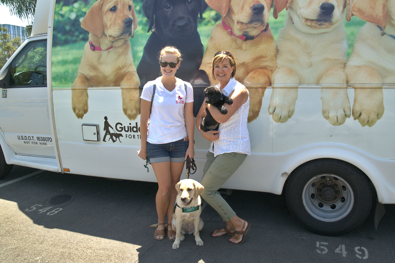 Kelsea with Amari and Denise with Jess at the Puppy truck