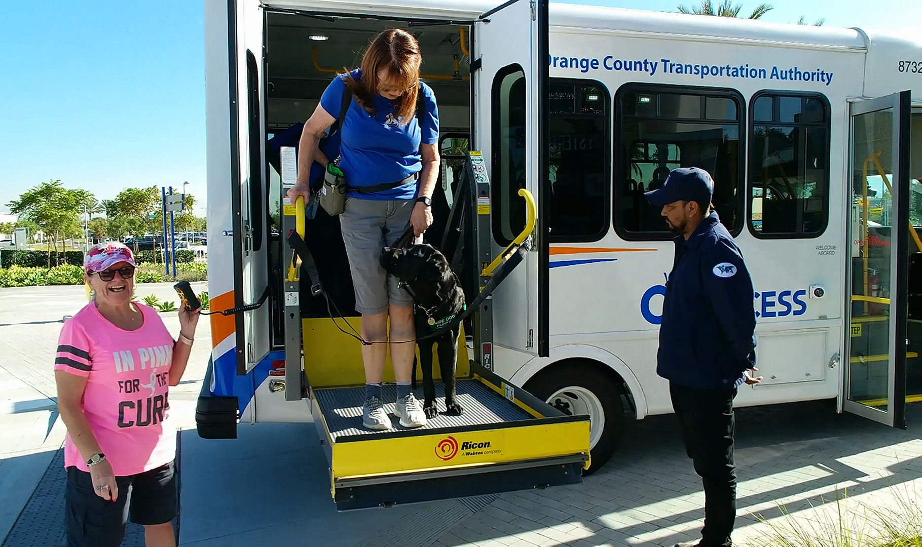 Brenda with Dash on bus lift