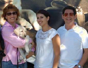 Karen, Manny, and Julie with Winsome at the Puppy Truck