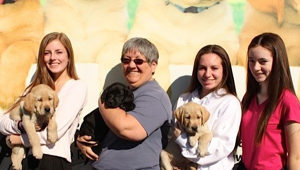 Katherine with Moira, Mindy, and Muesli at the Puppy Truck
