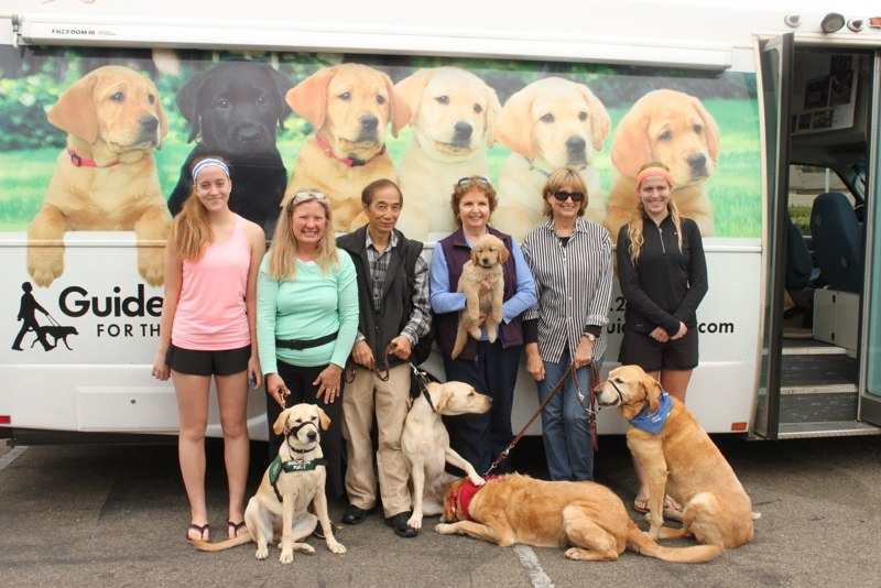 Sandra with Ava, Larry with Arbor, Pat with Miranda, Peggy with Hugo and Ottowa at the Puppy Truck