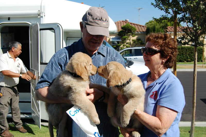 Greg with Natalia, Pat with Regan at the Puppy Truck