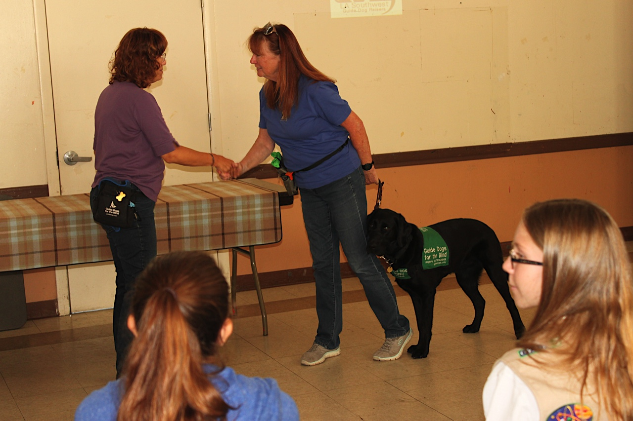 Karen demonstrating how-to-greet with Brenda and Dash