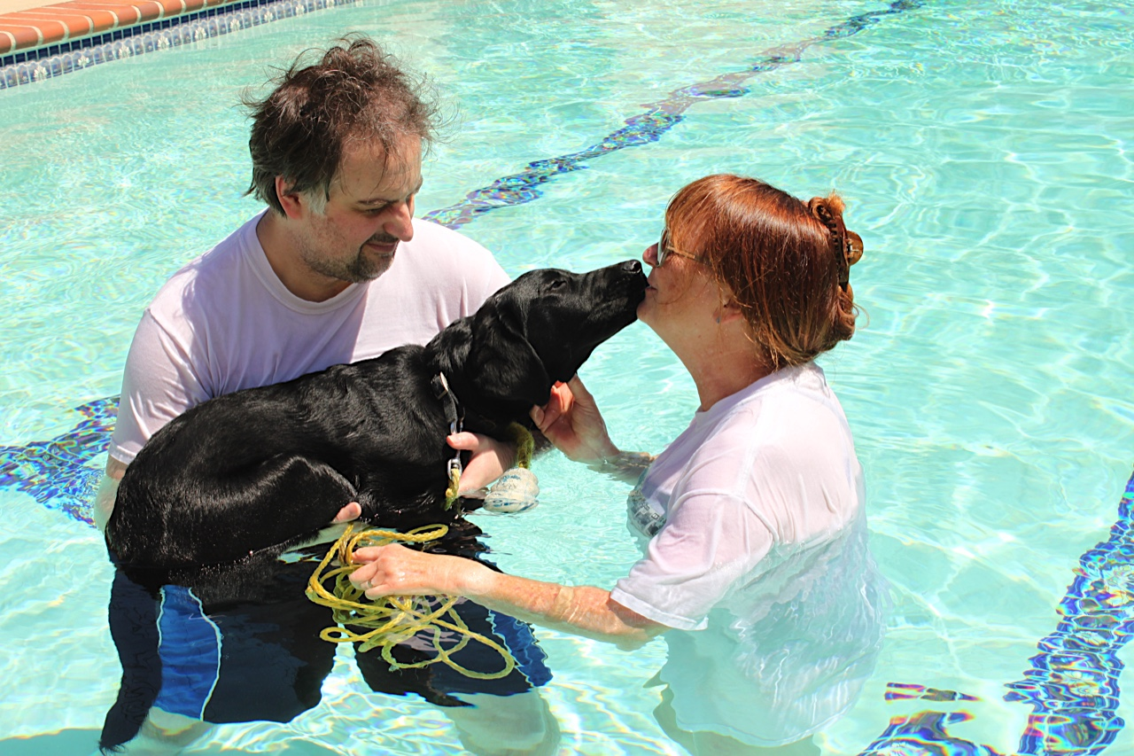 Tim and Brenda with Dash in the pool 2017-05-21