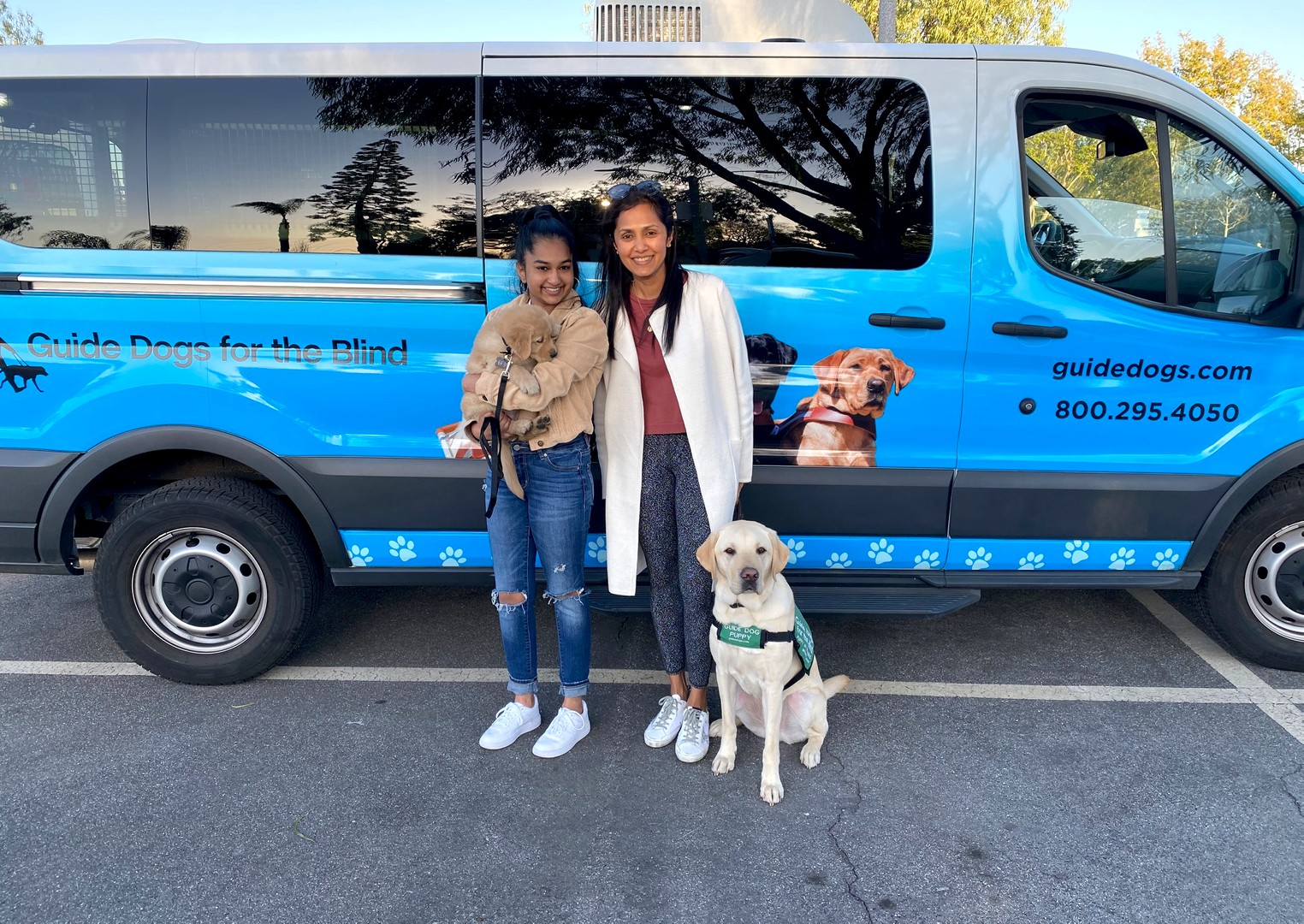 Avanthi with Puff and Daya with Kazuki at the puppy truck